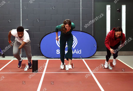 Stock Picture of Catherine Duchess of Cambridge (centre) races against para-athlete sprinter Emmanuel Oyinbo-Coker and heptathlete Jessica Ennis, during a SportsAid event at the London Stadium in Stratford