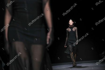 Stock Picture of A model presents a creation by Thierry Mugler fashion house during the Paris Fashion Week, in Paris, France, 26 February 2020. The presentation of the Fall-Winter 2020/21 women's collection runs from 24 February to 03 March 2020.