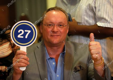 German Roland Henning poses for the photographers after acquiring the artwork by Cuban artist Roberto Fabelo, priced at 170,000 US dollars (156,400 euros), at an auction within the Habanos Festival, at Melia Havana Hotel in Havana, Cuba, 26 February 2020. Roberto Fabelo will give the money to the Cuban health system.