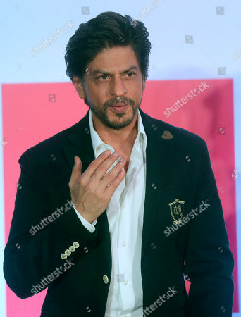 Bollywood actor Shah Rukh Khan greets media as he leaves after presenting the Shah Rukh Khan La Trobe University PhD Scholarship to a student in Mumbai, India