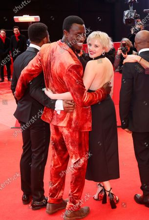 Welket Bungue (C-L) and Jella Haase arrive for the premiere of 'Berlin Alexanderplatz' during the 70th annual Berlin International Film Festival (Berlinale), in Berlin, Germany, 26 February 2020. The movie is presented in the Official Competition at the Berlinale that runs from 20 February to 01 March 2020.