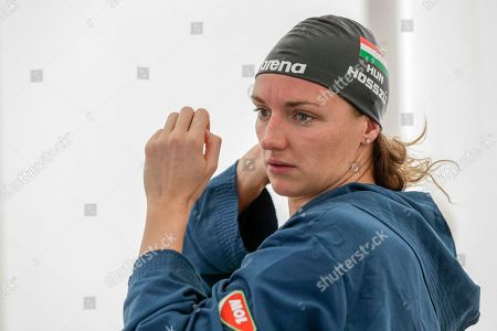 Hungarian swimmer Katinka Hosszú wears her swimming cap before starting a training session, in Naples, . If any thoughts were creeping into their minds that the Tokyo Olympics might be canceled due to a viral outbreak, elite swimmers Katinka Hosszú, Chad le Clos and Sarah Sjöström certainly didn't show it during a strenuous two-hour training session Wednesday
