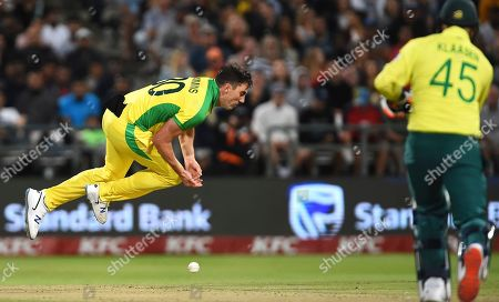 Australia's Patrick Cummins misses a catch during the 3rd and final T20 cricket match between South Africa and Australia at Newlands Cricket stadium in Cape Town, South Africa