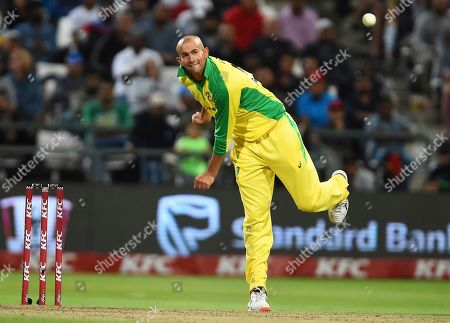 Australia's Ashton Agar bowls during the 3rd and final T20 cricket match between South Africa and Australia at Newlands Cricket stadium in Cape Town, South Africa