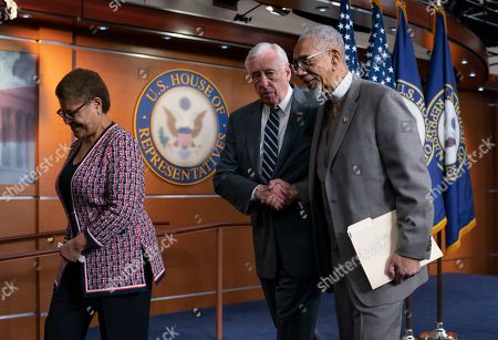 """Bobby Rush, Steny Hoyer, Karen Bass. From left, Rep. Karen Bass, D-Calif., chair of the Congressional Black Caucus, House Majority Leader Steny Hoyer, D-Md., and Rep. Bobby Rush, D-Ill., leave a news conference after discussing the """"Emmett Till Antilynching Act"""" which would designate lynching as a hate crime under federal law, on Capitol Hill in Washington, . Emmett Till was a 14-year-old African-American who was lynched in Mississippi in 1955, after being accused of offending a white woman in her family's grocery store"""