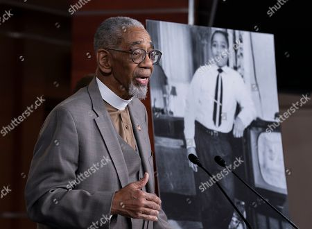 """Rep. Bobby Rush, D-Ill., speaks during a news conference about the """"Emmett Till Antilynching Act"""" which would designate lynching as a hate crime under federal law, on Capitol Hill in Washington, . Emmett Till, pictured at right, was a 14-year-old African-American who was lynched in Mississippi in 1955, after being accused of offending a white woman in her family's grocery store"""