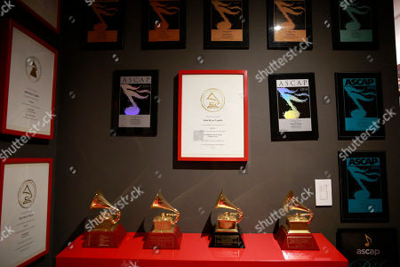Awards hang on the wall in Colombian producer Julio Reyes Copello's new Abbey Road Institute, in Miami. The Abbey Road Institute announced that it will open its first music school in the United States in partnership with Copello