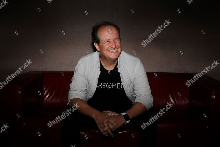 Stock Image of Colombian producer Julio Reyes Copello appears during an interview about a new Abbey Road Institute, in Miami. The Abbey Road Institute announced that it will open its first music school in the United States in partnership with Copello