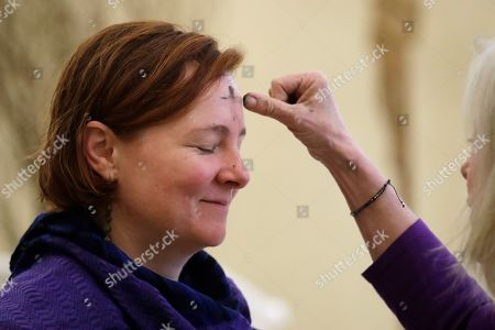 Anna Roach has ashes in the sign of a cross placed on her forehead by Judy Davis during an Ash Wednesday service at Christ Our Hope Catholic Church, in downtown Seattle. Ash Wednesday marks the beginning of Lent, a solemn period of 40 days of prayer and self-denial leading up to Easter