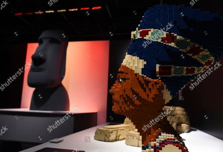 """The LEGO sculptures """"Nefertiti,"""" right, and """"Moai"""" are pictured at a media preview of """"The Art of the Brick"""" exhibition at the California Science Center, in Los Angeles. The exhibit, which features more than 100 works of art created from over one million LEGO bricks by contemporary artist Nathan Sawaya, opens on February 28"""
