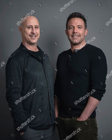 """Gavin O'Connor, left, and actor Ben Affleck pose for a portrait in New York to promote their film """"The Way Back"""