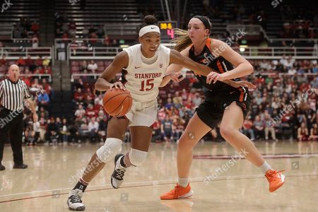 Stanford forward Maya Dodson (15) dribbles against Oregon State forward Taylor Jones during an NCAA college basketball game in Stanford, Calif