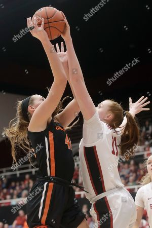 Stanford forward Ashten Prechtel, right, defends a shot by Oregon State forward Taylor Jones during the first half of an NCAA college basketball game in Stanford, Calif