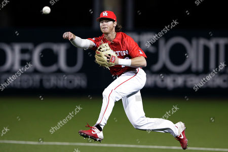 Houston second baseman Ian McMillan fields a ball against UT Rio Grande during an NCAA baseball game, in Houston, Texas