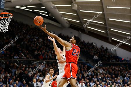St. John's Nick Rutherford, right, goes up for a shot against Villanova's Collin Gillespie during the first half of an NCAA college basketball game, in Villanova, Pa