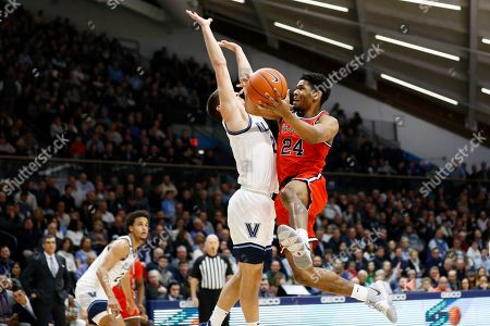 Stock Picture of St. John's Nick Rutherford (24) goes up for a shot against Villanova's Collin Gillespie (2) during the first half of an NCAA college basketball game, in Villanova, Pa