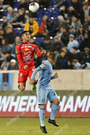Christian Martinez, Ronald Matarrita. San Carlos midfielder Christian Martinez leaps up for a header next to New York City FC defender Ronald Matarrita during the first half in the second leg of a CONCACAF Champions League soccer match, in Harrison, N.J
