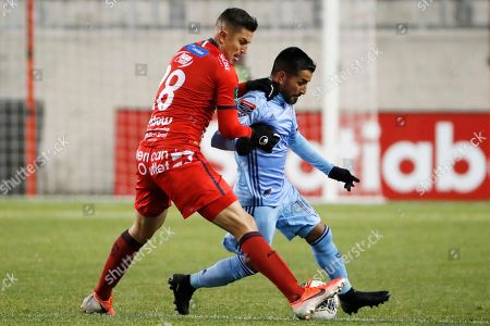 Lucas Meza, Maximiliano Moralez. San Carlos midfielder Lucas Meza gets his hands on New York City FC midfielder Maximiliano Moralez (10) during the second half in the second leg of a CONCACAF Champions League soccer match, in Harrison, N.J. NYCFC won 1-0