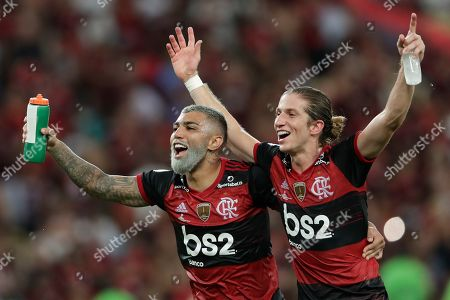 Gabriel Barbosa of Brazil's Flamengo, left, and teammate Filipe Luis celebrate defeating 3-0 Ecuador's Independiente del Valle in the the final match of the Recopa at the Maracana stadium in Rio de Janeiro, Brazil