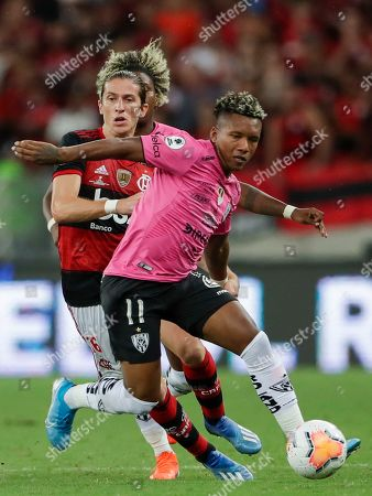 Jhon Sanchez of Ecuador's Independiente del Valle is challenged by Filipe Luis of Brazil's Flamengo during the final match of the Recopa at the Maracana stadium in Rio de Janeiro, Brazil