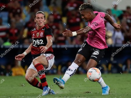 Jhon Sanchez of Ecuador's Independiente del Valle, right, and Filipe Luis of Brazil's Flamengo vie for the ball during the final match of the Recopa at the Maracana stadium in Rio de Janeiro, Brazil