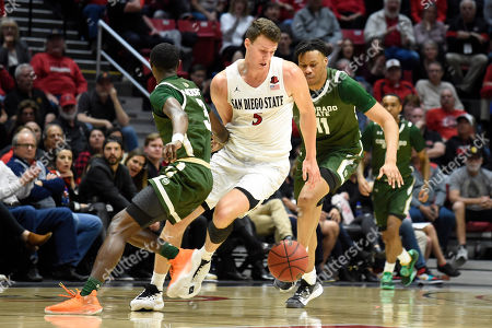 Yanni Wetzell, Kendle Moore, Dischon Thomas. San Diego State forward Yanni Wetzell (5) steals the ball from Colorado State guard Kendle Moore (3) and Dischon Thomas (11) during an NCAA college basketball game against Colorado State, in San Diego