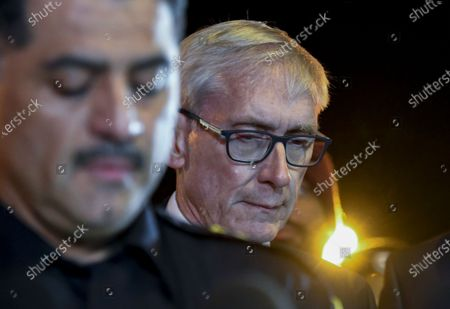 Stock Image of Milwaukee Police chief Alfonso Morales (L) speaks during a press conference as Wisconsin Governor Tony Evers (R) looks on outside the Molson Coors campus in Milwaukee, Wisconsin, USA, 26 February 2020. According to media reports, an employee who had been fired from the Molson Coors Brewing Company earlier in the day, returned and killed at least five employees before taking his own life.