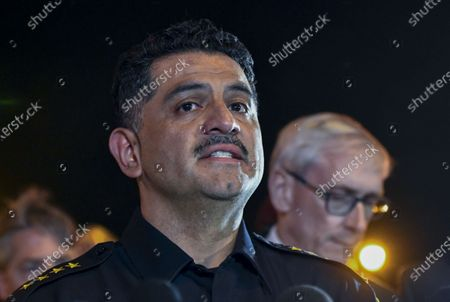 Milwaukee Police chief Alfonso Morales (C) speaks during a press conference as Wisconsin Governor Tony Evers (R) looks on outside the Molson Coors campus in Milwaukee, Wisconsin, USA, 26 February 2020. According to media reports, an employee who had been fired from the Molson Coors Brewing Company earlier in the day, returned and killed at least five employees before taking his own life.