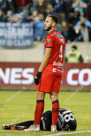 San Carlos defender Fernando Brenes calls for a trainer after AD San Carlos goalkeeper Patrick Pemberton was injured on a goal score by New York City FC during the first half in the second leg of a CONCACAF Champions League round of 16 soccer match, in Harrison, N.J