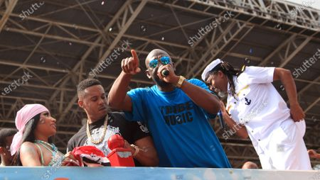 Kenneth Petty (2-L), husband of US rapper Nicki Minaj (L), stands between the leader of the band Legends Of The Far East, famous local artist Iwer George (2-R), and his wife as Trinidadian singer Machel Montano (R) looks on, during the Trinidad and Tobago Carnival in Port of Spain, Trinidad and Tobago, 26 February 2020. Minaj apologized on 26 February for her husband's behavior after a video showing Petty pushing a well-known local artist. The man had touched Minaj to allegedly encourage her in her performance.