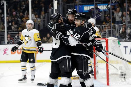 Los Angeles Kings' Trevor Lewis, center, celebrates his goal with Blake Lizotte, left, and Trevor Moore during the second period of an NHL hockey game against the Pittsburgh Penguins, in Los Angeles