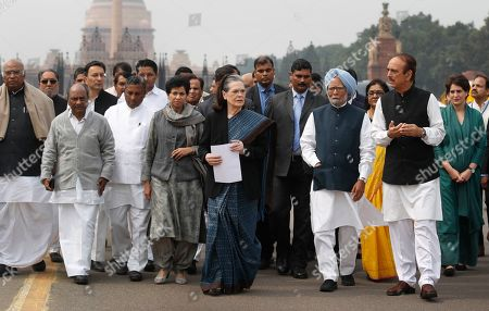 Congress party President Sonia Gandhi, center, along with party leaders leave the presidential palace after submitting a memorandum to the president on the recent violence in Delhi in New Delhi, India, . India accused a U.S. government commission of politicizing communal violence in New Delhi that killed at least 30 people and injured more than 200 as President Donald Trump was visiting the country. The violent clashes between Hindu and Muslim mobs were the capital's worst communal riots in decades and saw shops, Muslim shrines and public vehicles go up in flames