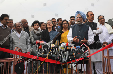 Former Indian prime Minister Manmohan Singh, center right, makes a press statement with Congress party President Sonia Gandhi, center, and party leaders after submitting a memorandum to the president on the recent violence in Delhi in New Delhi, India, . India accused a U.S. government commission of politicizing communal violence in New Delhi that killed at least 30 people and injured more than 200 as President Donald Trump was visiting the country. The violent clashes between Hindu and Muslim mobs were the capital's worst communal riots in decades and saw shops, Muslim shrines and public vehicles go up in flames