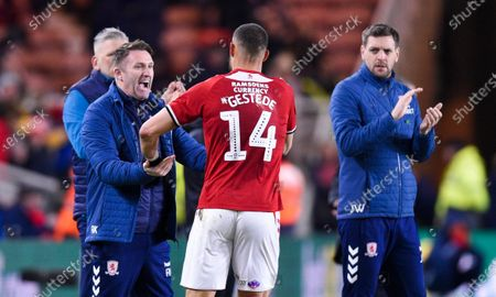 Rudy Gestede of Middlesbrough celebrates with Assistant Manager Robbie Keane of Middlesbrough and Manager Jonathan Woodgate