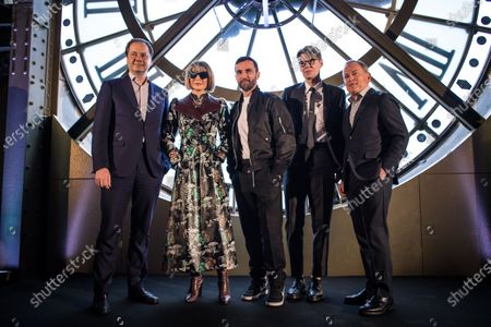 (L-R) Mark Hollein, director of the Metropolitain Museum of Art (MET), Editor in Chief of US Vogue magazine Anna Wintour, French designer Nicolas Ghesquiere and Andrew Bolton, curator at the MET Costume Institute pose during the presentation of the exhibition 'About Time: Fashion and Duration' at the Orsay Museum in Paris, France, 27 February 2020. 'About Time' will run at the Costume Institute of the Metropolitan Museum of Art in New York, USA from 07 May to 07 September 2020.