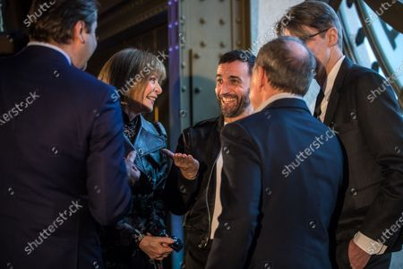 (L-R) Mark Hollein, director of the Metropolitain Museum of Art (MET), Editor in Chief of US Vogue magazine Anna Wintour, French designer Nicolas Ghesquiere and Andrew Bolton, curator of the MET Costume Institute, talk during the presentation of the exhibition 'About Time: Fashion and Duration' at the Orsay Museum in Paris, France, 27 February 2020. 'About Time' will run at the Costume Institute of the Metropolitan Museum of Art in New York, USA from 07 May to 07 September 2020.