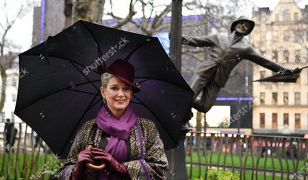 Patricia Kelly, widow of US actor Gene Kelly, poses in from of a statue of Gene Kelly in Trafalgar Square in London, Britain, 27 February 2020. Leicester Square is marking a century of cinema in the square with the  unveiling of statues honoring cinematic greats.