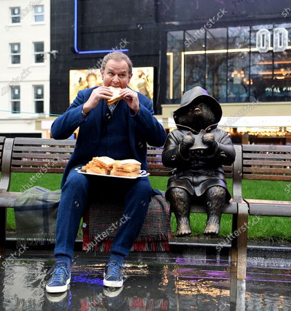 Hugh Bonneville unveils a new Paddington Bear statue in Trafalgar Square in London, Britain, 27 February 2020. Leicester Square is marking a century of cinema in the square with the  unveiling of statues honoring cinematic greats.