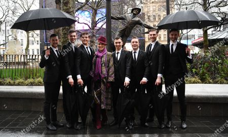 Patricia Kelly (4-L), widow of US actor Gene Kelly, poses with dancers in front of a statue of Gene Kelly in Trafalgar Square in London, Britain, 27 February 2020. Leicester Square is marking a century of cinema in the square with the  unveiling of statues honoring cinematic greats.