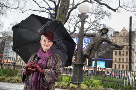 Patricia Kelly, wife and biographer of Gene Kelly, unveils a statue of Gene Kelly in Singin' in the Rain as part of Discover LSQ's film statue trail 'Scenes in the Square'.