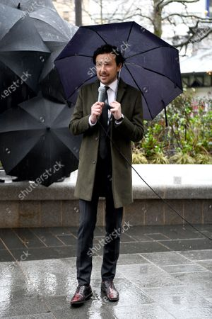 Stock Picture of Alex Zane unveils a statue of Gene Kelly in Singin' in the Rain as part of Discover LSQ's film statue trail 'Scenes in the Square'.
