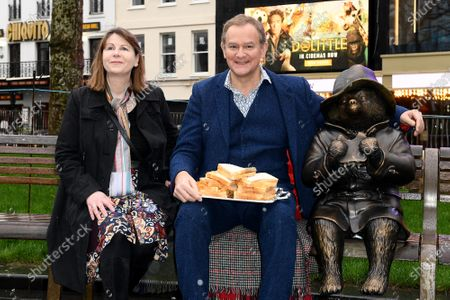 Rosie Alison and Hugh Bonneville, star of Paddington and Paddington 2, unveils a Paddington statue as part of Discover LSQ's film statue trail 'Scenes in the Square'.