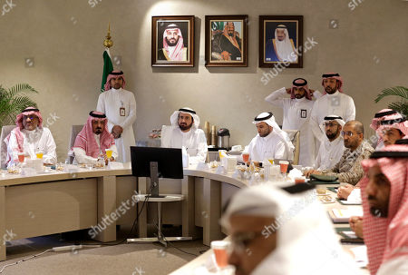 Tawfiq Al Rabiah. Saudi Health Minister Tawfiq Al-Rabiah, center left, meets with health officials to discuss the latest situation on coronavirus, at the Saudi Food and Drug Authority in Riyadh, Saudi Arabia, . Saudi Arabia halted travel to the holiest sites in Islam over fears of the global outbreak of the new coronavirus just months ahead of the annual hajj pilgrimage. At top photos show Saudi King Salman, right, his Crown Prince Mohammed bin Salman, left, and Saudi Arabia's founder late King Abdul Aziz Al Saud