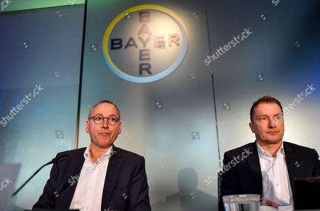 CEO Werner Baumann and CFO Wolfgang Nickl of Bayer AG, from left, sit at the Financial News Conference in Leverkusen, Germany, . The German drug and chemical company announced increased sales of 43.545 billion euros and a net income of 4.091 euros for 2019. Bayer is still facing major legal battles over the Roundup weed killer after the acquisition of Monsanto in 2018