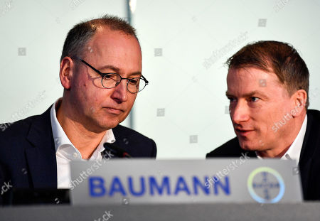 CEO Werner Baumann listens to CFO Wolfgang Nickl of Bayer AG, from left, at the Financial News Conference in Leverkusen, Germany, . The German drug and chemical company announced increased sales of 43.545 billion euros and a net income of 4.091 euros for 2019. Bayer is still facing major legal battles over the Roundup weed killer after the acquisition of Monsanto in 2018