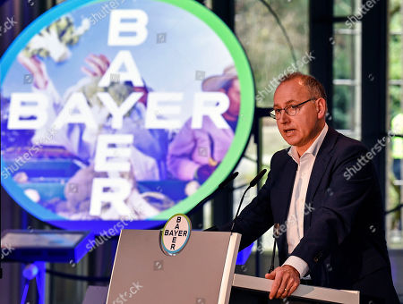 CEO Werner Baumann of Bayer AG talks to the media at the Financial News Conference in Leverkusen, Germany, . The German drug and chemical company announced increased sales of 43.545 billion euros and a net income of 4.091 euros for 2019. Bayer is still facing major legal battles over the Roundup weed killer after the acquisition of Monsanto in 2018