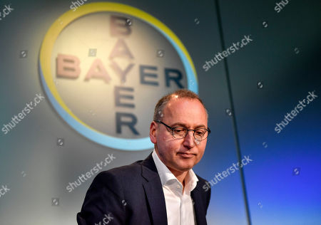 CEO Werner Baumann of Bayer AG arrives at the Financial News Conference in Leverkusen, Germany, . The German drug and chemical company announced increased sales of 43.545 billion euros and a net income of 4.091 euros for 2019. Bayer is still facing major legal battles over the Roundup weed killer after the acquisition of Monsanto in 2018