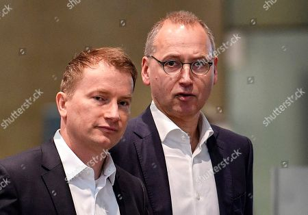 CEO Werner Baumann and CFO Wolfgang Nickl of Bayer AG, from right, arrive at the Financial News Conference in Leverkusen, Germany, . The German drug and chemical company announced increased sales of 43.545 billion euros and a net income of 4.091 euros for 2019. Bayer is still facing major legal battles over the Roundup weed killer after the acquisition of Monsanto in 2018