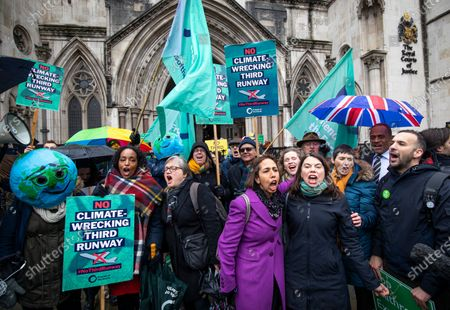 Stock Picture of Liberal Democrat MP for Richmond Park Sarah Olney (4-L) celebrates with Friends of the Earth staff and supporters outside the High Court after judges ruled that the planned expansion of Heathrow Airport was illegal over climate change.