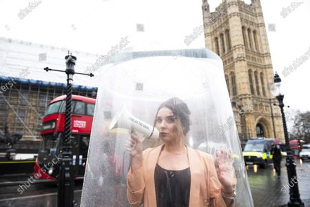 Celebrity publican, Candice Brown protesting outside Parliament today to mark the day that British beer drinkers have already paid the same amount of Beer Duty as Germany will pay all year.